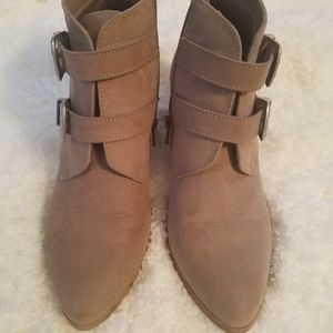 Tan heeled buckle booties